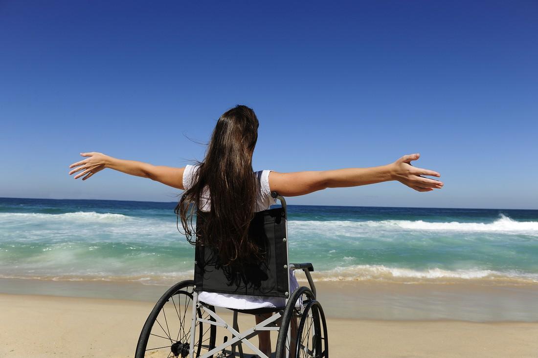 1594535376-woman-in-wheelchair-enjoying-life.jpeg